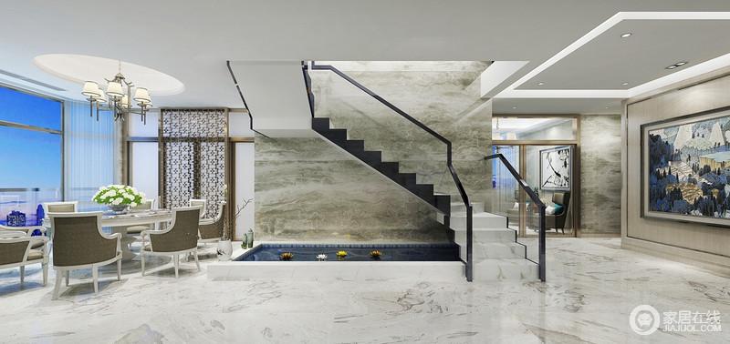 楼梯下方的自然景观池与端景墙上的绯画意境呼应,餐厅与走廊天花顶的