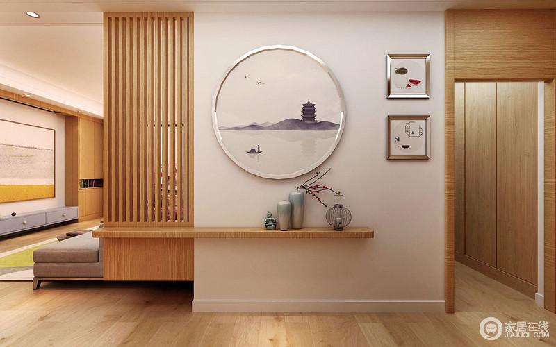银色框装饰的独舟风景画及绘图简单中表达出对生活的解读;陶瓷瓶和木