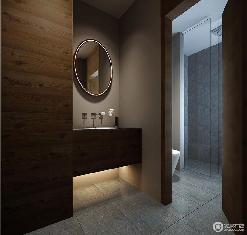 青灰色的地面延伸至淋浴间的墙面,形成视觉上的延展,通透的玻璃将干湿