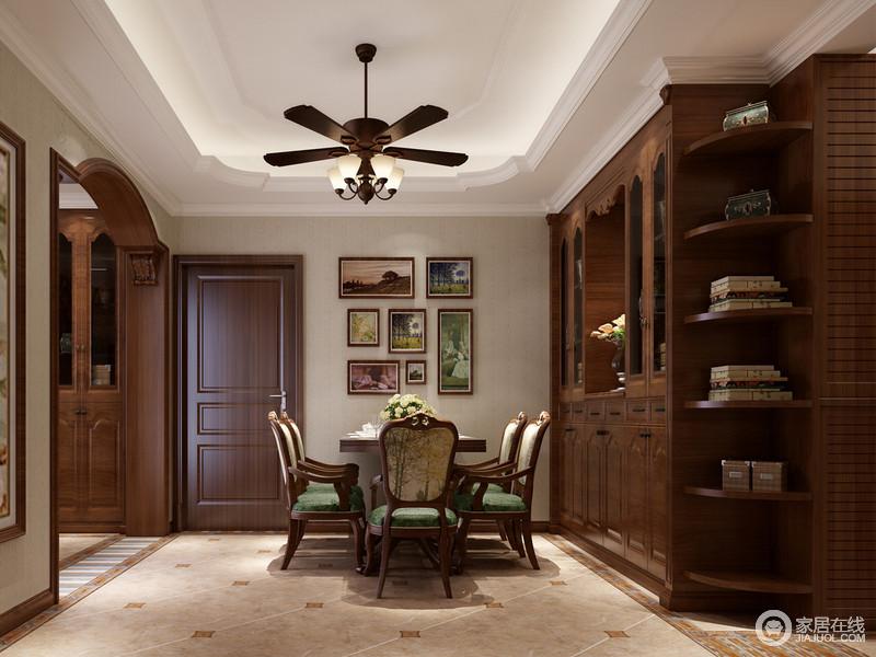 餐厅与客厅通过拱形门形成分隔,同样以半开放式书柜为