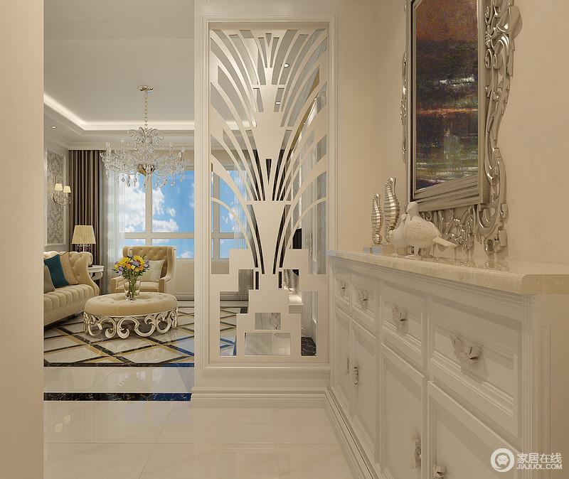 装修图库 客厅 欧式 玄关采用粉黄与莹白色调,独特造型的镂空屏风诠释
