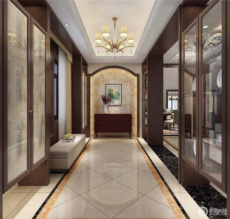 玄关端景处采用拱形门洞,嵌入浅橙色大理石,石面菱形斜纹勾勒,与走廊