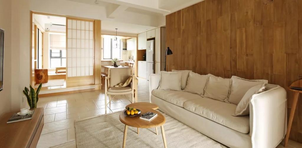 客厅和开放式的餐厨区域及阅读功能区,很好的结合在一起。