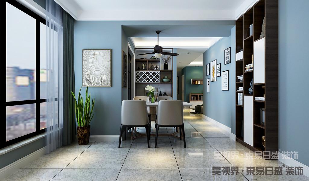 餐厅的设计以灰蓝色为主色调,在视觉上,有着极强的平衡感。
