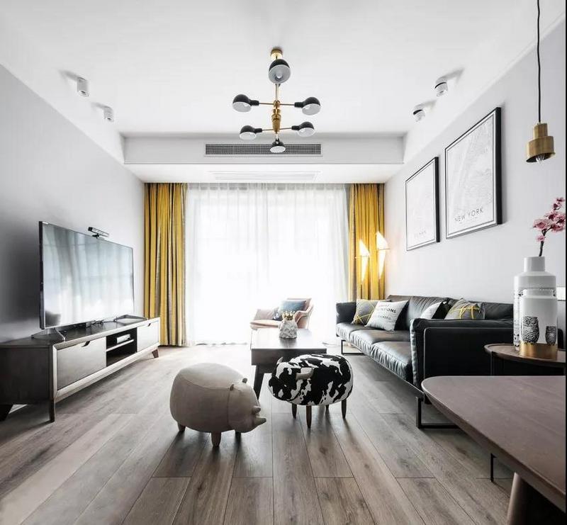 客厅墙面颜色运用了灰色调,简约舒适的基调营造安逸自在的氛围。