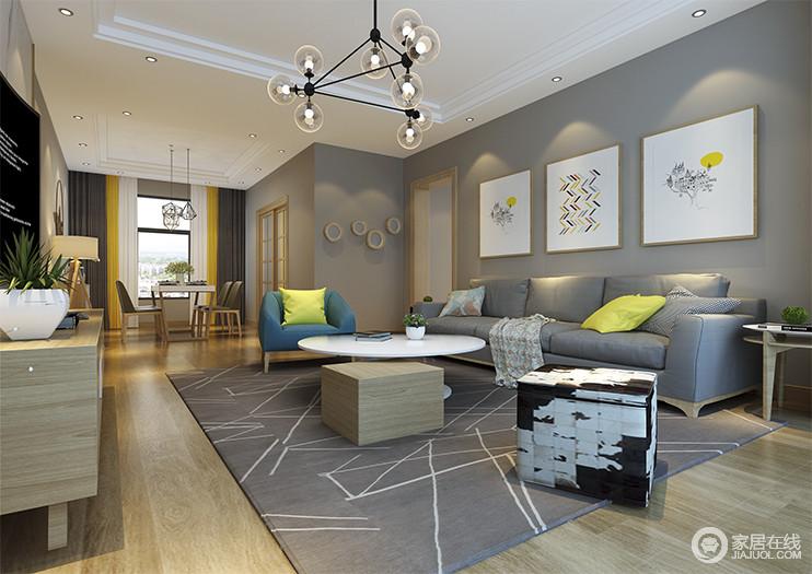 北欧风情的基础款沙发搭配原木圆形茶几,细腻的质感确实让整个设计看上去更为精致。