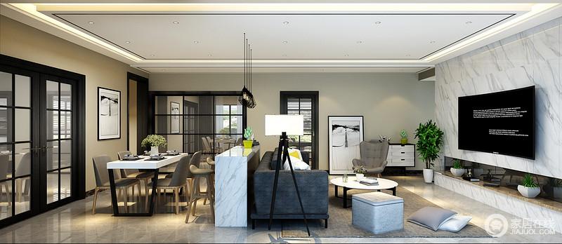 一眼望去,客厅与餐厅毫无阻拦的一体,令整个大空间显得非常通透开阔;灰蓝布艺沙发与灰白大理石吧台、一组黑色悬挂吊灯,则无形中作为分界点,又保持空间的相对独立性。