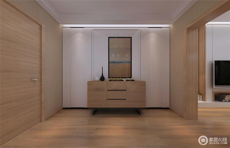 玄关的整体结构以木材为主,平实而简单的设计令空间现代感十足,没有冗余的形式,而是以实木玄关柜的简洁来表达生活的真谛;白色墙面上田野的艺术画与柜上的黑白陶艺品点缀出个性,不乏趣味性。