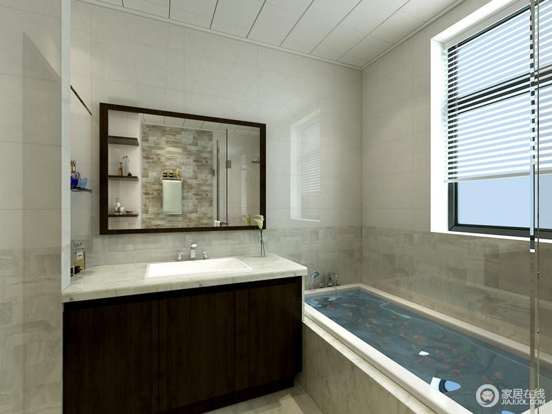 卫生间的面积比较紧凑,设计师合理安排各个功能区域,使空间不但规整有序更满足屋主的各方面需求;墙面采用拼接式样,使紧凑的空间里不失趣味。