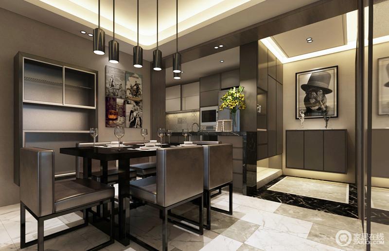 入口的门厅以定制得收纳柜来增加空间的实用性,一副幽默地动物画作与黑色、白色的几何地砖形成呼应,让空间多了立体效果;餐厅与厨房通过吧台区分,却并没有减少互动性;褐色橱柜与现代餐椅延续了空间的主调,沉稳而颇显质感;铁艺筒灯与有趣地画作组合,给予空间艺术个性,让生活更为精致。