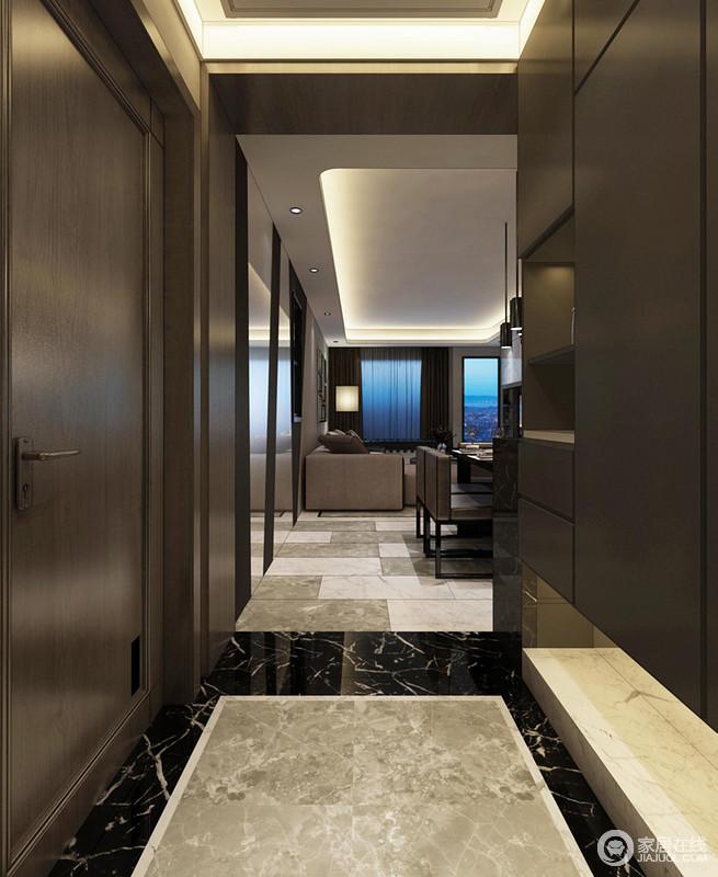 走廊的地砖以灰色、白色和黑色为主,通过拼接式铺贴的方式,让空间看似简单,却张扬着工艺和设计感;褐色实木定制得收纳柜与整体空间氛围相契合,给予空间现代沉稳。