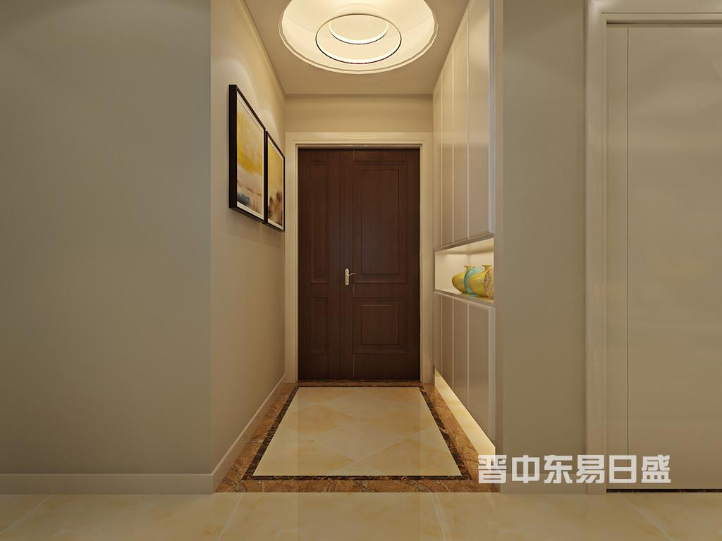 门厅墙体拆改之后重新规划,设计上追求天圆地方的传统概念,简单的灯具与顶部装饰吊顶相得益彰,地面瓷砖45度斜贴试图从视觉上可以起到拉伸空间的作用。