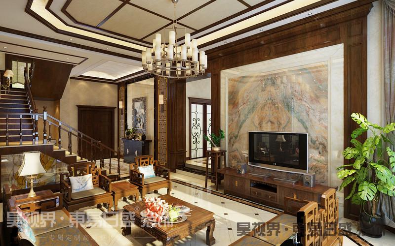 客厅是一个空间最为凸显整体效果之处,本案采用奢华沉稳的中式经典红木家具、诗词古画,搭配简约的地砖,是中式与现代完美结合的典范。