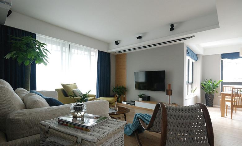 沙发背景运用了灰色的乳胶漆来搭配。