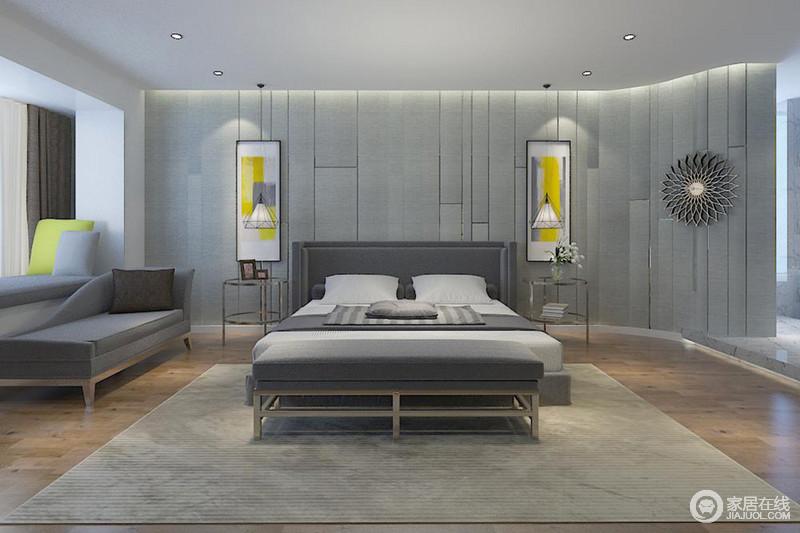 卧室线条简单,软包墙面以灰色装裱,多了沉静素雅,同时因为线条设计减去了平淡;铁艺三角形吊灯和黄色简画、金属圆几对称出简约之美,金属向日葵低调地悬挂在一角,装饰出时尚;灰色系双人床和沙发等柔软,让生活舒适、宁静。