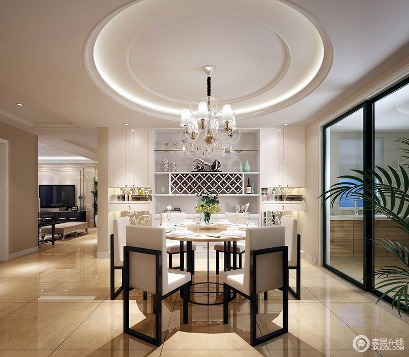 开放式的餐厅少了局限,并以玻璃推拉门与厨房分隔;设计师巧妙地将白色收纳柜与墙体连为一体,不仅整体结构感强,而且超级实用,收纳出空间美学;圆形穹顶增强了空间的轻贵感,与圆形餐桌呼应着,而创意十足地矩形实木餐凳与之组成方圆之美,让用餐更加温和雅静。