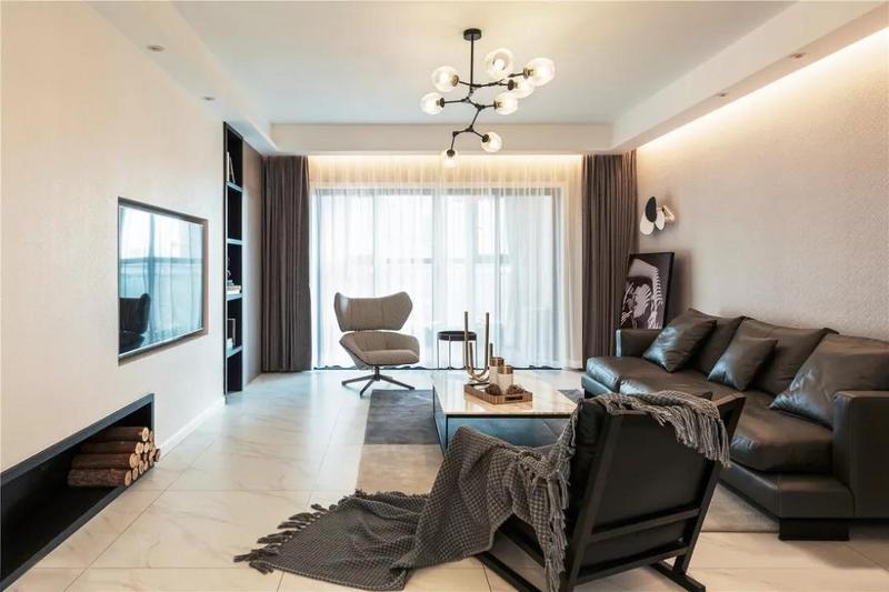 海吉布材质让客厅大面积的白色不再单调,精简的硬装让空间框架更为突出。