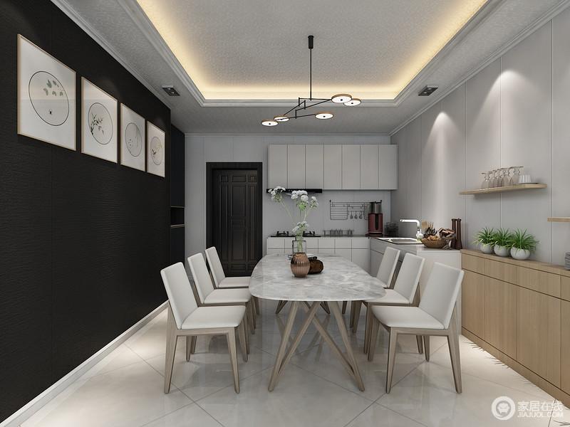 空间十分规整,墙面以黑白色调的冲撞,加深空间的对比美学,并张扬着抽象艺术,黑色墙面的中式简画多了简雅;白色橱柜简单而功能至上,与白色地砖让空间显得明快,古木制成的现代桌椅多了时尚,与原木收纳柜和悬挂架陈列的家居品,让空间浓郁着生活的雅意和情调。