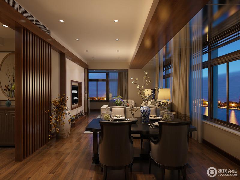 客餐厅一体的空间里,大玻璃窗带来全景营造,空间洋溢着充足的休闲氛围;天花顶上镜面与木质拼接,呼应着电视墙上的木线,让空间自然感与休闲感结合;餐桌椅的搭配看似中规中矩,但优雅的弧线在传统中式元素点缀中,传递出几许诗情。