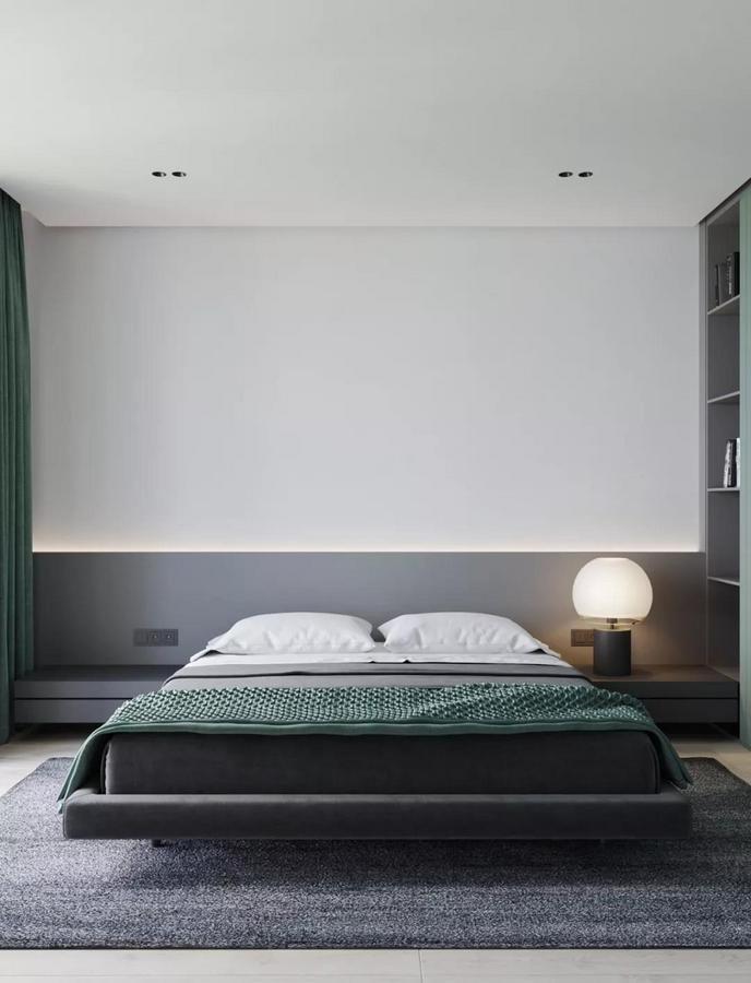 整个卧室墙面摆脱了千篇一律的大白墙 而是采用白+灰的拼接设计 来营造出空间的与众不同 灰色部分还能当成床头背景墙 既可以形成视觉分区 又与深灰色地面进行了巧妙呼应