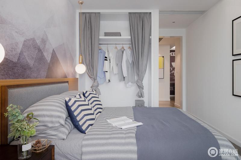 卧室灰与白的搭配,让整个空间显得十分静谧。