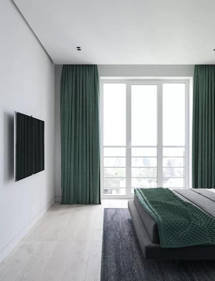 窗帘与床品也使用了相同的色调 让整体看起来更加 清新和舒适