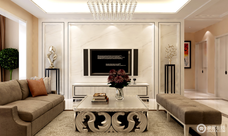 对称式的电视背景墙和互相辉映,茶几上的花卉让略显冰冷的空间有了温度,让家有了温馨感。