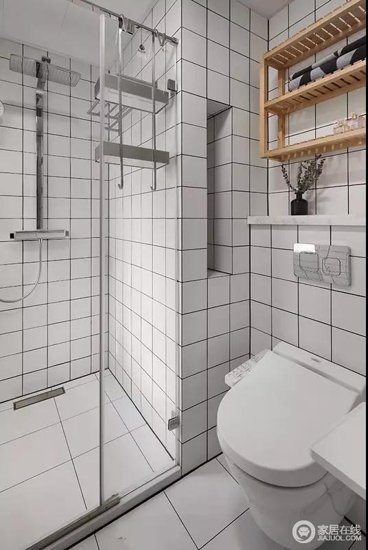 卫生间,墙面地面都贴满了白色黑边的方形瓷砖,防水效果特别好!