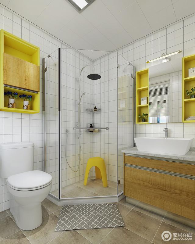 卫生间以仿木纹地砖铺贴地面,与盥洗柜的木质构成空间的自然朴质;白色小方砖铺贴墙面带来一种简约之美,与黄色收纳柜让生活清新而不失实用,角落里的淋浴间让沐浴更为私人化。
