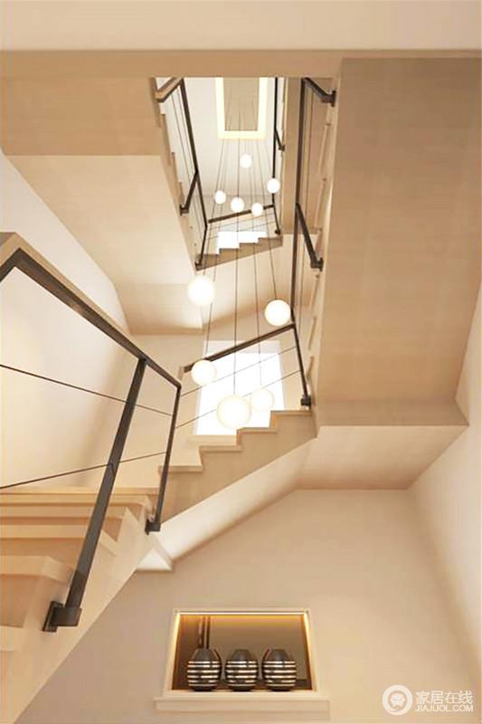 楼梯的设计以层叠的结构与稳重的建筑设计演绎现代设计的质感,简约的铁质楼梯没有掩盖空间感,反而对比出石材美学和质感;比例吊顶从上而下,一泻千里的感觉,更具动态。