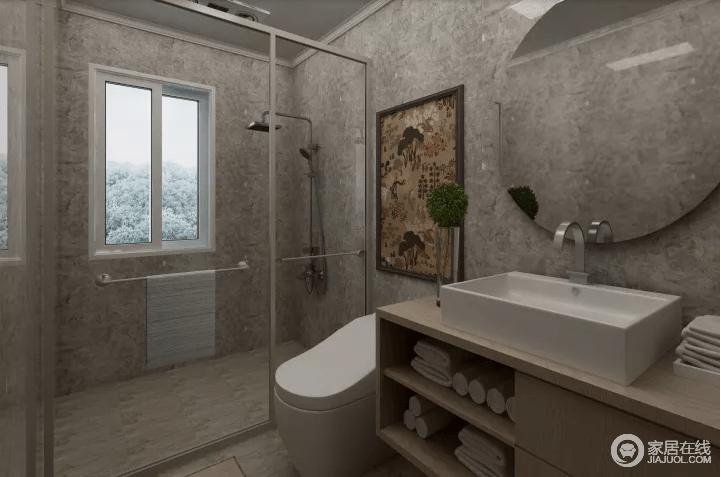 卫生间灰色釉面砖铺贴墙面平滑而硬朗,砖面的成色让整个空间多了自然原始的朴质;玻璃门将空间区域分割,以干湿分离的设计,提升生活的舒适性;简约的盥洗柜将毛巾等用品收纳起来,方形台盆和圆镜以几何趣意,让空间更为大气。