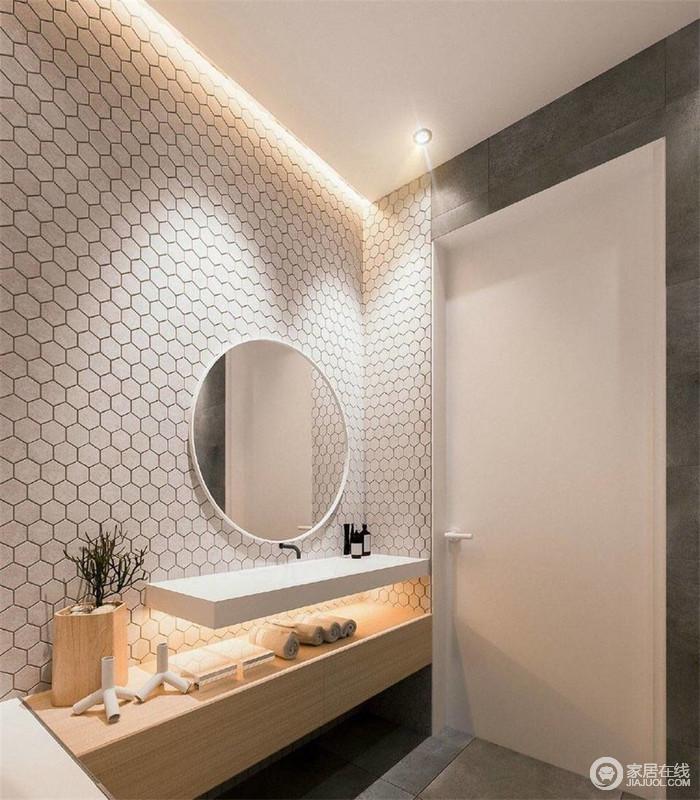 中性的色彩,让人不自觉放松起来;多边形墙面铺贴出几何感,十分唯美;圆形镜子和悬挂式盥洗台以简约艺术装饰出空间之雅,实木盥洗柜带着自然之调,存留着实用哲学。