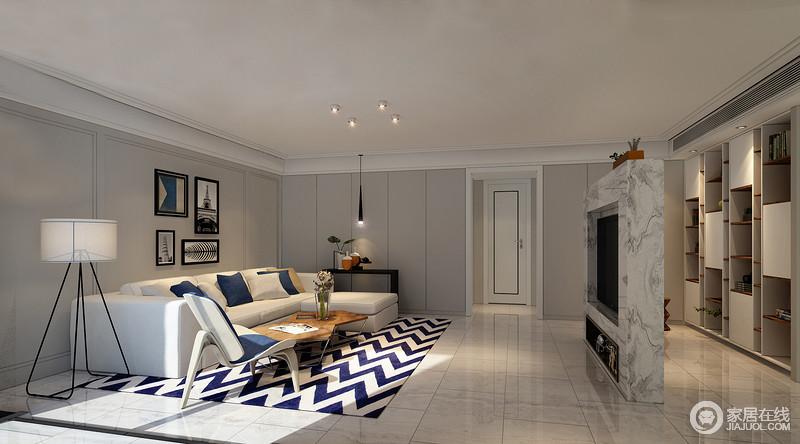 客厅没有多余装饰,地面仿石纹的瓷砖铺贴,让整个空间视觉延伸;素净的墙面搭配大理石打造的电视背景墙,给人一种宁静的氛围;白色沙发搭配蓝白波纹地毯,与简约个性的家具组成时尚。