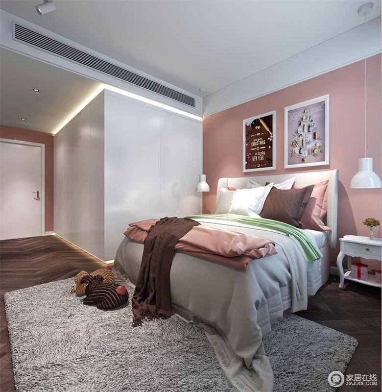 次卧选用了皮粉色,活泼而又时尚,同时与白色整体式衣柜构建出甜美;背景墙的简画与白色悬挂式吊灯以对称的方式,给家增彩;灰色的地毯与彩色系床品添置了温馨。