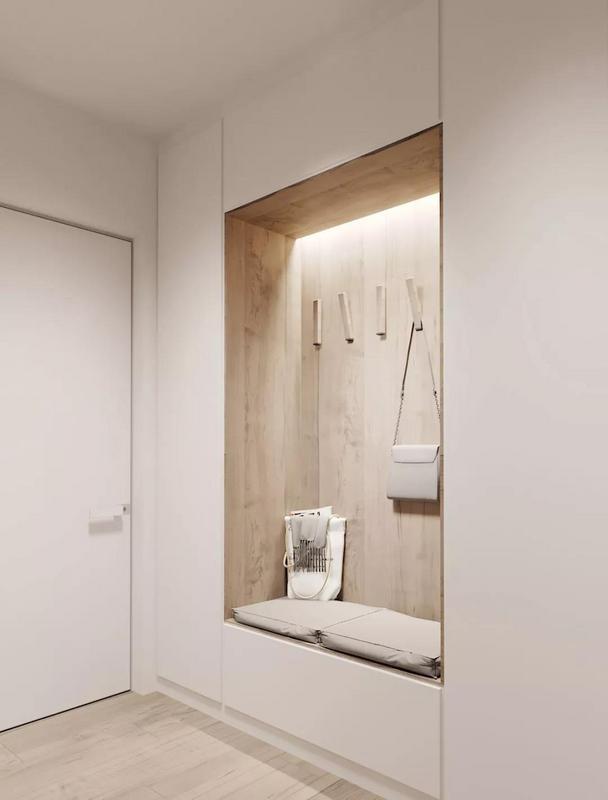 多功能的玄关壁柜, 集衣架、储物柜和换鞋凳为一体, 既实用又美观, 让不大的空间同样拥有很强的储物功能。