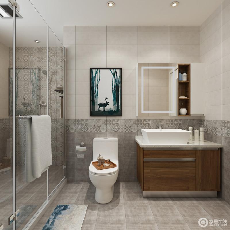 卫生间以灰驼色砖石铺贴墙面,并通过灰色砖石和拼花砖,凸显铺贴工艺,也让空间具有了动律;玻璃淋浴室解决了干湿问题,褐色盥洗柜带来沉稳的基调,裹挟着镜面储物柜和挂画,让空间实用与美观并存。