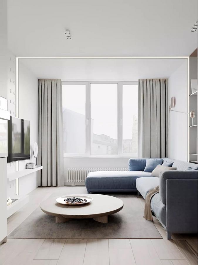 充满设计感的电视背景墙也是一大亮点, 一半为光洁的纯白色, 另一半做了立体的圆形印花, 既与玄关处的墙面形成呼应, 也让空间变得更加耐看、有趣。