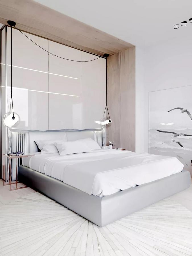 女主人的卧室同样延续了简约格调, 但又在简洁纯粹的空间里, 隐藏了不少细节上的小惊喜。  比如床头两侧悬挂下来的艺术灯饰, 就是主卧的点睛之笔。 它在满足照明需求的同时, 又让一种浪漫的生活情调跃然而出。