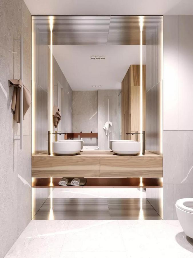 就连卫生间的设计也用心至极, 通过灯光效果和不同材质的运用, 呈现出满满的精致感。
