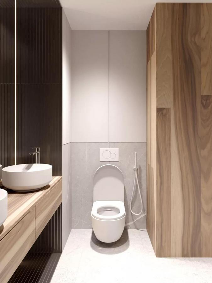 碍于空间面积的狭小, 卫生间的功能布局略显紧凑, 但在使用方面未受多大影响, 确保了洗漱区和马桶区的互不干扰。