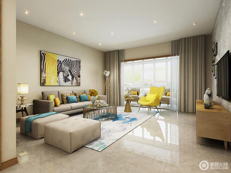 跳跃活泼的黄色与优雅蓝色活力揉进空间,将现代时尚明媚张扬的展现;不同饱和度的灰色运用在沙发和地面上,与米色墙面相近,形成空间温和理智的打底基调,令空间愈加凸显亮色彩的愉悦情致。