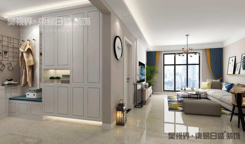 推门而入,是一个独立空间的玄关,一面白色定制的鞋柜加上换鞋凳设计,实用而又美观,色彩上也给人一种冲击的审美效果。