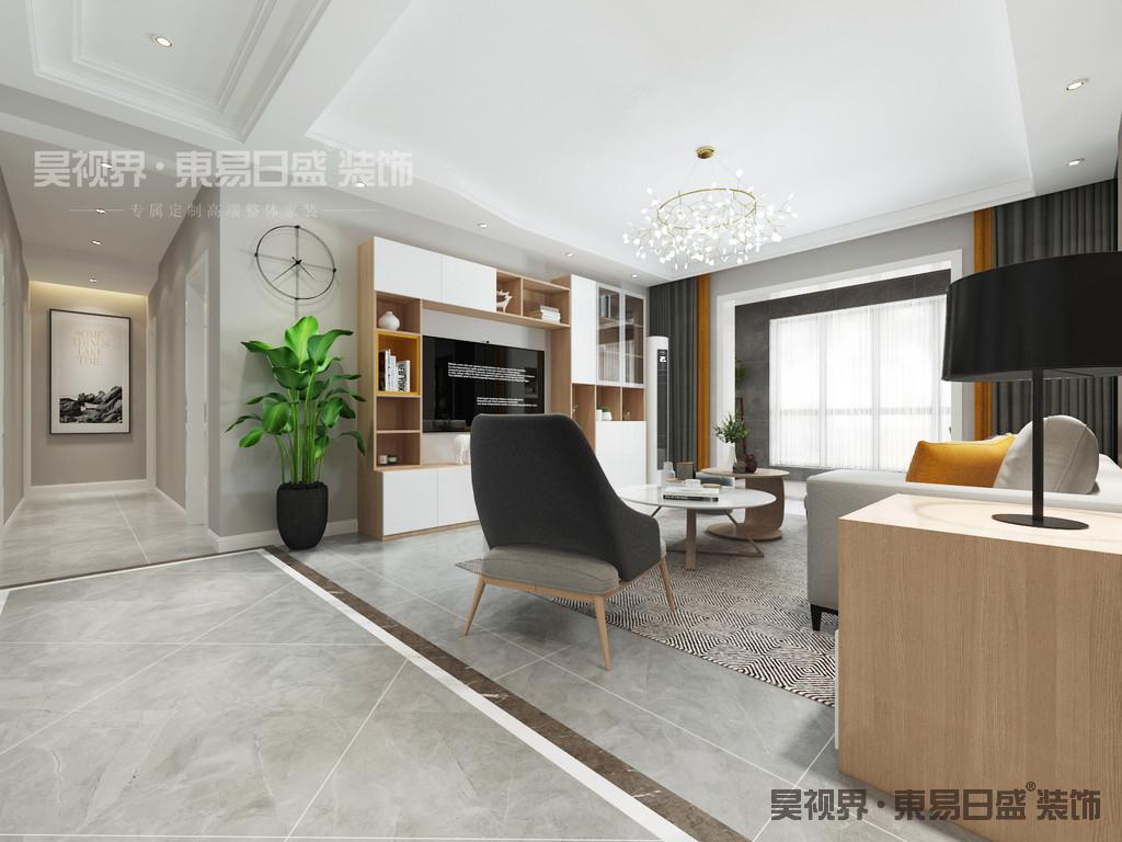 一张沙发一个茶几一个电视柜,简单的线条,简单的组合。