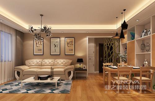 入户门厅直对餐厅,设计师以镂空屏风加以阻隔;客厅布置简约但并不简单,背景墙饰以艺术画作映衬,现代欧式沙发柔软舒适,色调上的相近带来柔和舒适;而跳跃活泼的几何地毯,则注入十足活力。