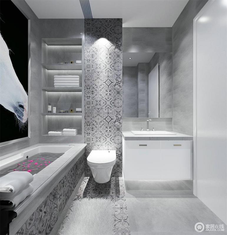 浅灰色水泥质感的地面清素柔和,让凝练的设计更显整洁,设计师通过对墙面的改建,打造出了置物台让沐浴更为便利;灰色花砖的摩洛哥风带来时尚,简约的镜子和盥洗台和净有加。