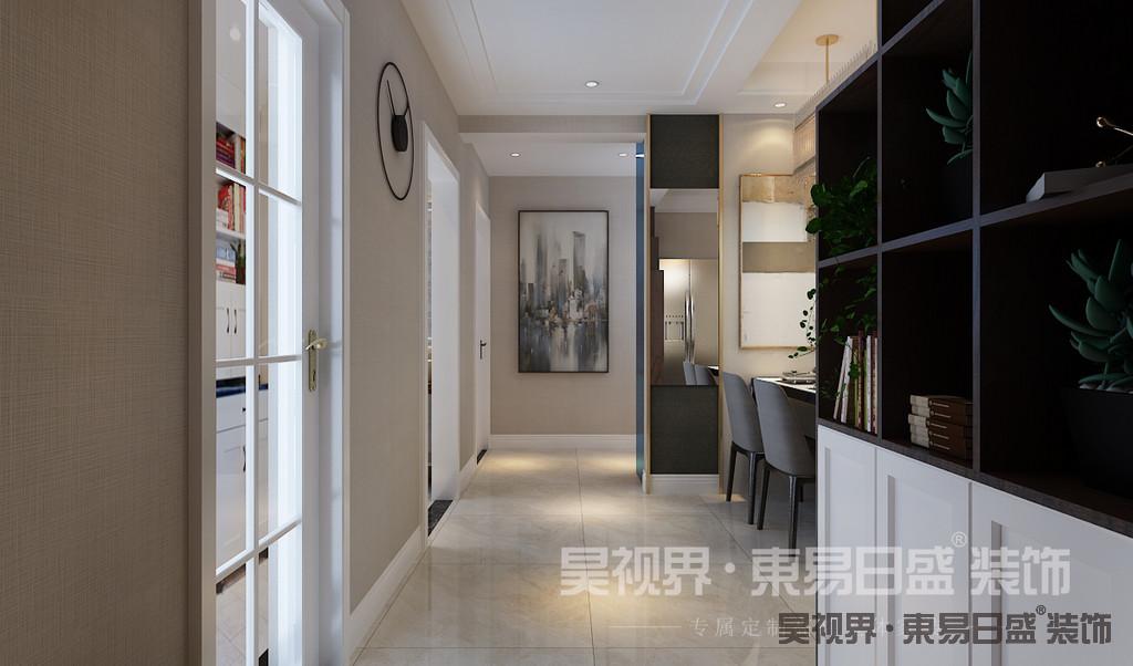 玄关处运用实木打造了柜子,深色调与浅色墙面形成鲜明对比,墙漆与客厅相呼应,一切都十分和谐融洽。