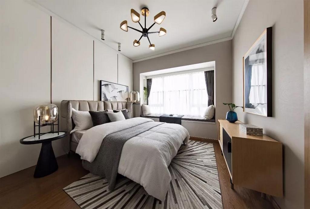 主卧延续整体风格,空间轻快温和 木质收纳柜舍弃花哨的造型 回归舒适与宁静
