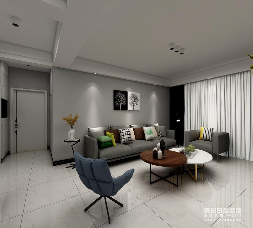 客厅背景墙与沙发在不同饱和度的灰色调下,展现出现代的宁静雅致;细脚的墨蓝懒人座椅与方正的灰布沙发形成对比,中央叠加的茶几也在色彩和材质中碰撞,空间简约但不简单。