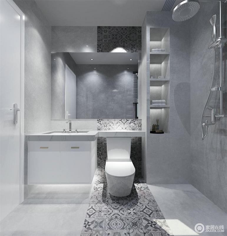 卫生间并没有太多的家具,通过重建墙体的形式隔出了置物台,简洁实用,同时具有原始感;灰色调的空间以马赛克花砖装饰出时尚,一扫沉闷,而镜面悬挂柜和白色盥洗柜形成纯净和雅韵。