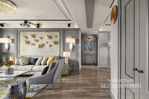 本案采用硬朗简洁的直线条,让空间具有一定的层次感。布艺的沙发不单单柔合了硬装带来的线条感,还和灰色背景墙完美的融合了一起,通过彩色的沙发靠枕来丰富空间的颜色,原木色地板让空间多了分温馨,空间里摆放的花卉让空间生机感十足。